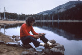 Richard on a backpacking trip in the mountains of Montana - panning for gold - no luck (8/1972)