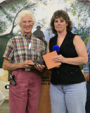 Traci Koch presenting  volunteer hour coordinator award to Dolly Watkins