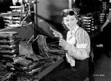 Evelyn Turner 18  welder. She is shown welding a Bren gun magazine at the John Inglis Co. Bren gun plant may 1941