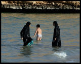 Boy taking a bath with his sisters - Oman 2004