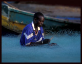 Fisherman mending the nets - Bakau
