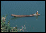 Going down River Gambia in wooden canoe