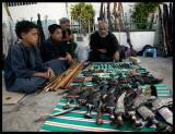 Old guns, ammo & daggers for sale at Salalah city centre market