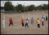 Early morning volleyboll game outside Green Island Park