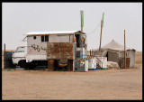 Small desert shop on the road to Al Abraq Oasis in the west