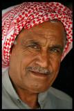 local shop owner in Al Abraq oasis
