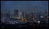 Heavy rainclouds hanging low over Kuwait city skyline