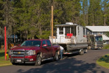 zP1010299 Caleb disconnects houseboat trailer from pickup.jpg
