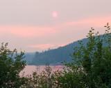 zP1010438 Wildfire-tinted sun at Lake Five near West Glacier Montana.jpg
