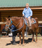 zP1010839 Dora ready to ride - as wranger checks horse and saddle.jpg