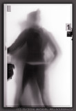 Person behind frosted glass