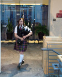 Bagpiper leads the procession