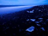 Iceberg Fragments On Black Sand
