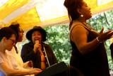 Aleah Long conducting, Esther Blue on keyboards, Deirdre & Yaniyah singing