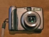 Canon 710 Camera , 7.1 Mega Pixs  and IS  ( Uses, just two AA batteries)