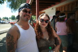 Happy Stampede Couple ( Great Tatoos And Lip Stick!)