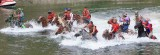 Brawn  And Muscle As Horses And Men Ride Across River