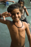 Children swim for coins in the Ganges, India