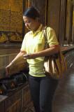 Giving alms at Wat Po, Bangkok