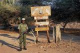 Guard with signpost at Mvuu Camp,  Liwonde National Park