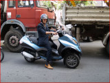 Brown Shoes and 3 Wheeled Scoot