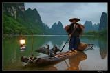 Li River cormorant fisherman at dawn, Guangxi.