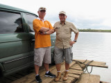 A RACER AND A BIRDER. My brother Jeff (left) ably piloted our birding vehicle, as he made the over 500 km trip to Malasi Lake in just under 10 hours, including wading through heavy traffic along the way.  Here, Jeff and birding buddy Neon pose by our car while we cross the mighty Cagayan river aboard a makeshift raft.