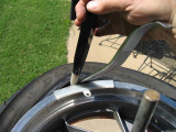 Tire iron used to pry bead over rim to prevent bending MoJo bar end