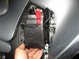 Battery slides out once bracket is removed