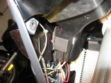 Horn relay mounted to air intake plenum