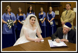 The Bride Looks into the Lens at the Ketubah Signing Ceremony