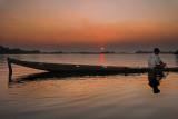 Boat at Sunset. Mekong