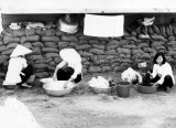 Maids washing Laundry