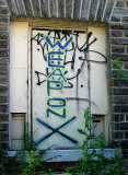 And the front door has new graffiti.