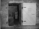 Btry Townsley test door C in open position, 1943. Note circular rifle rack and boxed supplies stacked inside.