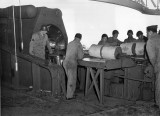 Loading powder bags at Btry #131. Red ends contained black powder igniter charge. (U.S. Army)