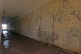 Access corridor to gun #1. Location of bunk brackets are still visible on walls at 73 spacing.