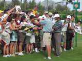 Tiger Woods mobbed by autograph seekers
