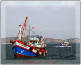 Fishing boats heading out