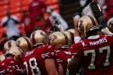 San Francisco 49ers huddle