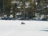 Snowmobile on Hills Pond