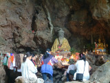 Statute in Cave of Sacred Fish -- Mae Hong Son