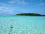 Mounu Island is surrounded by shallow, clear water, with Ovalu Island a few hundred yards away