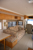 11- Living area with couch/lounger that converts to a queen bed