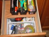 DESK JUNK DRAWER WITH SLIDING TOP PANEL FOR EASY ACCESS TO THE BOTTOM OF THE DRAWER