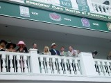 VIEW OF THE FOLKS IN THE RICH SEATS LOOKING OVER THE PADDOCK
