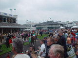 THE HORSES AND JOCKEYS ARE LED OUT OF THE PADDOCK TO THE GATES