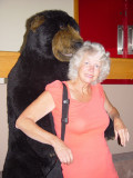 THE VISITOR'S CENTER'S BARNEY THE BEAR LOVED SARA AND GAVE HER A BIG HUG