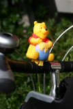 Pooh Bear on the handlebars
