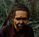 Face painted yellow mourning mud.